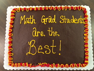 Grad students celebration cake